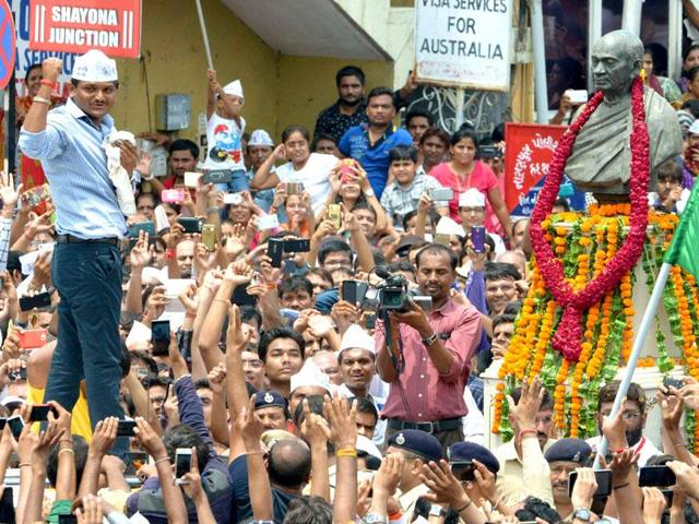 In this file photo, Patidar leader Hardik Patel raises his fist near the statue of Sardar Vallabhbhai Patel during a rally in Ahmedabad. The 22-year-old has been in jail since October.