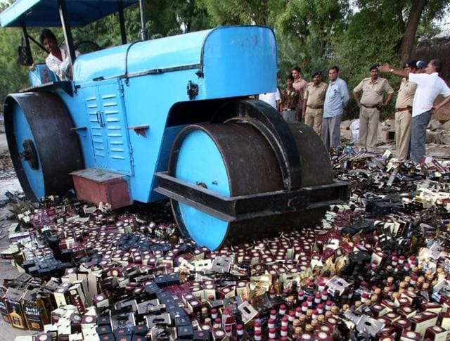 Seized liquor bottles being destroyed in Koba village, Gujarat, on May 26, 2007. Drinking and selling alcohol in Gujarat is prohibited(REUTERS)