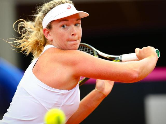 Coco Vandeweghe of the US hits a return against Sam Stosur of Australia during their women's singles tennis match.