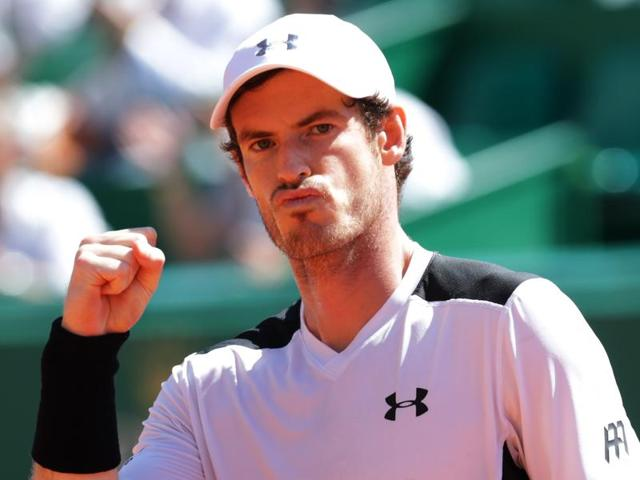 Britain's Andy Murray celebrates after defeating Canada's Milos Raonic.