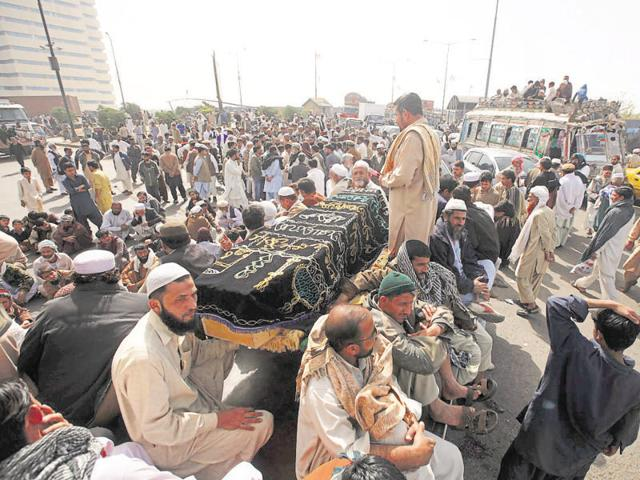 Residents of Lyari protest against rising crime in their area during a sit-in in Karachi.