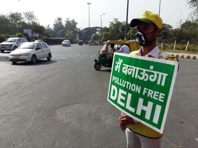 A volunteer at the Noida entry gate. The vehicular restrictions are effective from 8am to 8pm.
