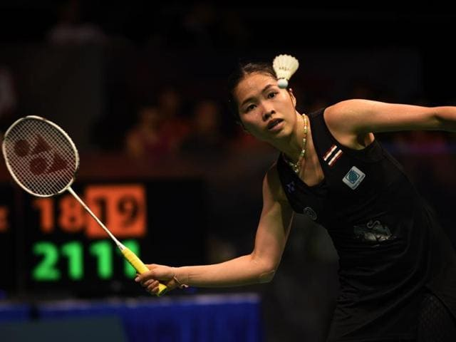 Ratchanok Intanon of Thailand hits a return against Sun Yu of China during the women's singles final at the Singapore Open badminton tournament in Singapore.