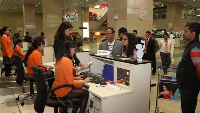 Passengers at a airline counter to collect boarding passes.