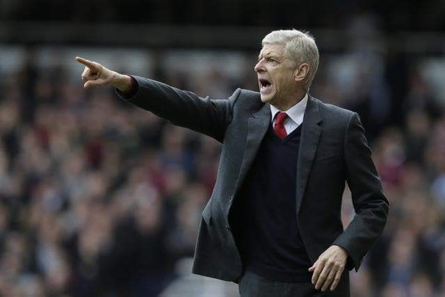 Arsenal manager Arsene Wenger gestures to his players during the English Premier League soccer match between West Ham United and Arsenal at Upton Park stadium in London, Saturday April 9, 2016. (AP Photo/Tim Ireland)