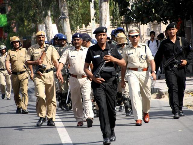 Haryana police personnel took out a flag march on Delhi Road, Rohtak, soon after the state government extended reservation benefits to Jats.