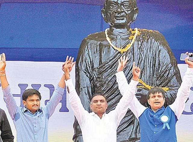 Patel agitation leaders Hardik and Lalji (in white shirt) along with others at a protest rally.