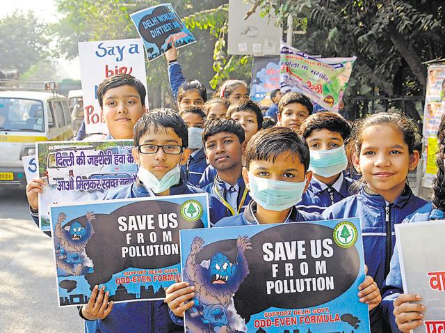 File photo of a rally taken out by school children in support of the Delhi government's odd-even initiative  at Janakpuri on December 15 last year.