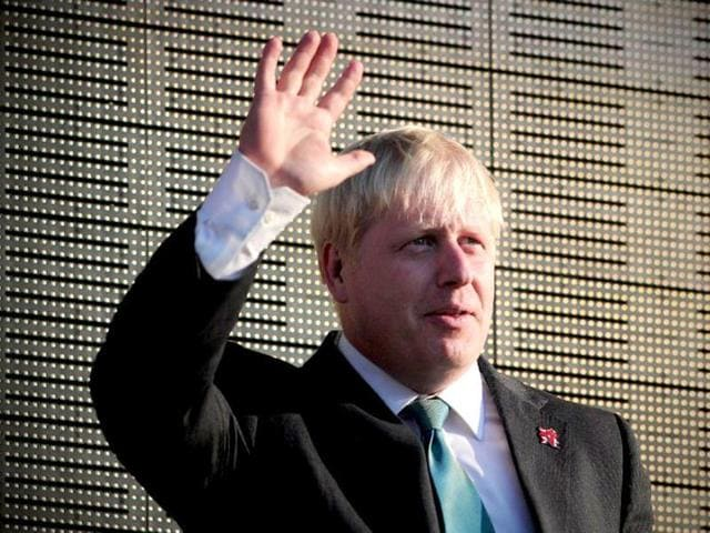 File picture of London Mayor Boris Johnson waving as he attends the Olympic Torch Relay Finale Concert in Hyde Park, central London.
