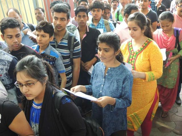 Students going inside exam center to take JEE (Main) exam in Lucknow  on April 03, 2016.