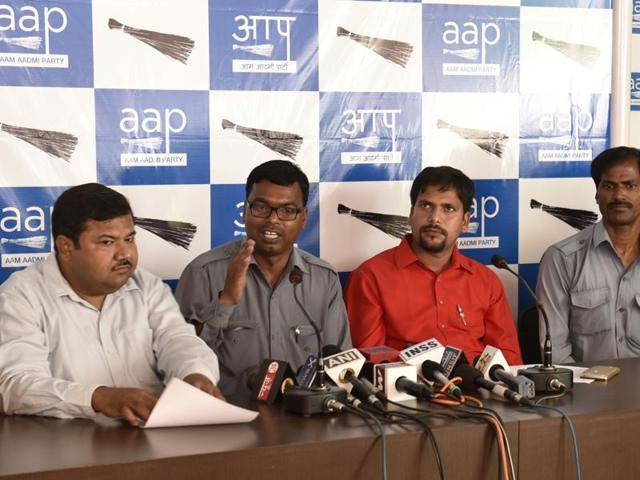 AAP leader Sanjiv Jha (second from right) along with the members of auto unions interact with journalists the party office in New Delhi.