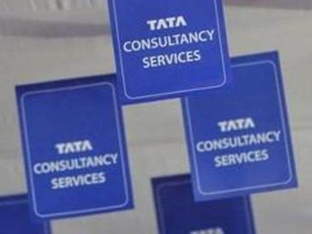 Logos of Tata Consultancy Services (TCS) are displayed at the venue of the annual general meeting of the software services provider in Mumbai.