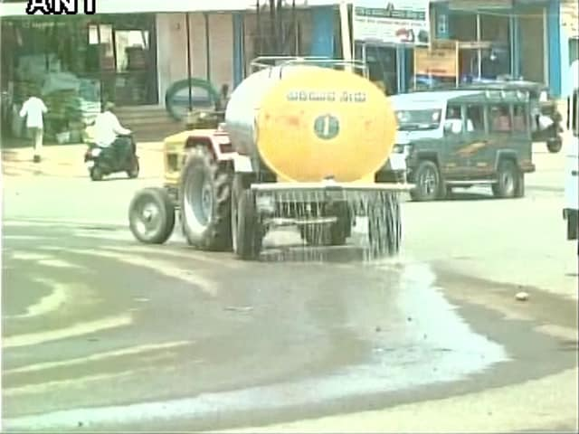 Water being sprinkled on road before CM Siddaramaiah's visit to drought-hit area.