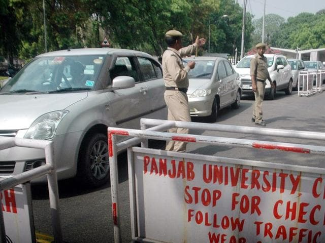 Vehicles queuing up to enter the university on Monday.