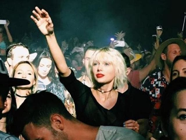 Taylor Swift attending a Calvin Harris concert in Coachella.