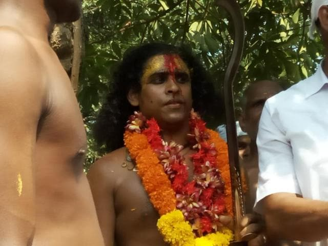 A devotee at Sri Kurumba Bhagavathy temple, where underprivileged castes assert themselves at a oracle festival.