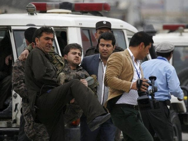 Security forces keep watch at the site of the explosion in Kabul.