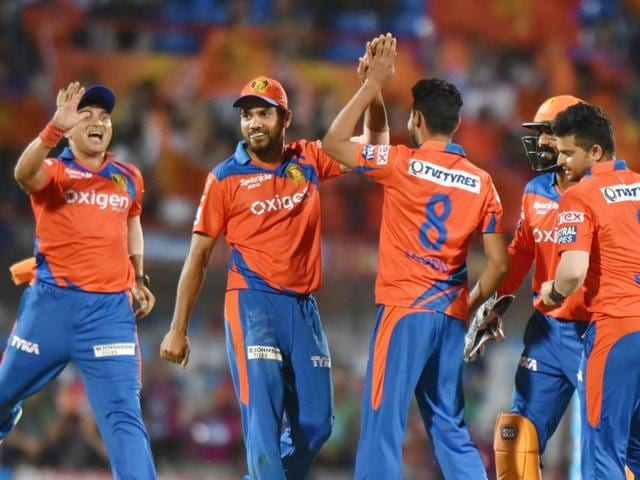 Players of Gujarat Lions celebrate during IPL match after wicket of Rising Pune Supergiants batsman at Saurashtra Cricket Association stadium in Rajkot in India, on Thursday, April 14, 2016.