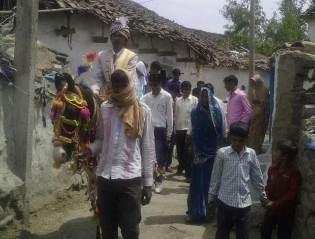 Bridegroom riding a horse at a village in Damoh district under police protection.