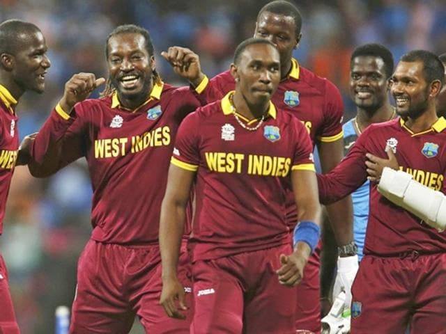 West Indies players celebrate after winning their match.