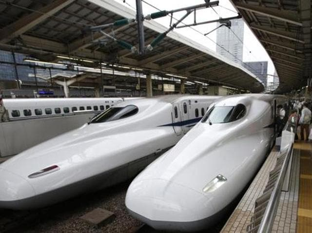 In file photo, passengers are seen boarding on the Shinkansen high-speed train at Tokyo station.