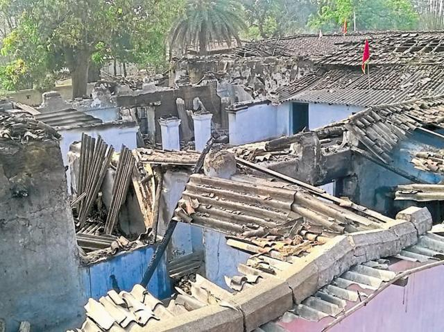The burnt remains of the house in which villagers burnt alive three members of a family in Lohardaga on Monday.