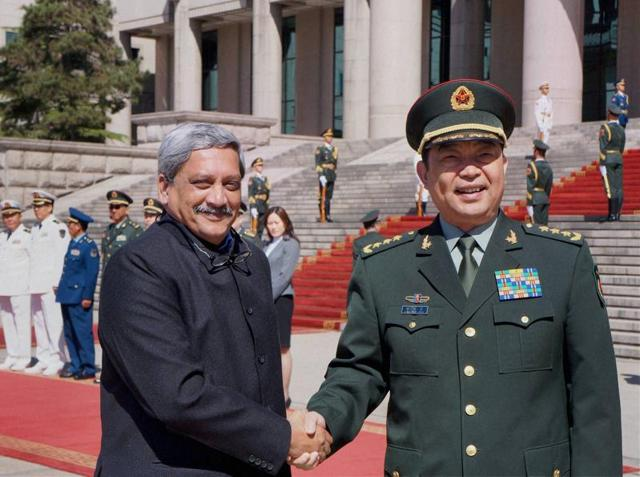 Defence Minister Manohar Parrikar being received by his Chinese counterpart Gen. Chang Wanquan at the PLA headquarters in Beijing on Monday.