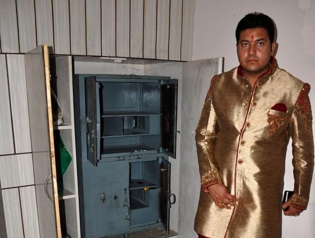 The bridegroom, Shiv Verma, at his ransacked house in Sunny Enclave, Kharar, on Monday.