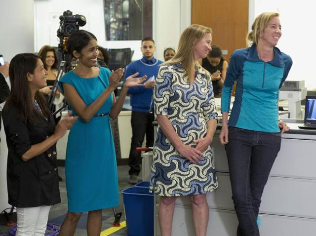 Associated Press reporters, left, Esther Htusan, Martha Mendoza, second right, Robin McDowell, right, and Margie Mason, on computer screen, joined by AP's international enterprise editor Mary Rajkumar, second left, celebrate as the AP wins the Pulitzer Prize for public service, in New York on Monday.