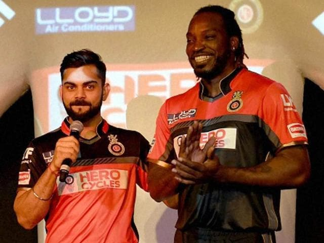 Royal Challengers Bangalore skipper Virat Kohli with teammate Chris Gayle during the launch of their team's jersey.