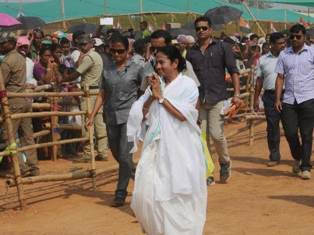 West Bengal CM and TMC chief Mamata Banerjee greets people during an election rally at Silda in Midnapur.