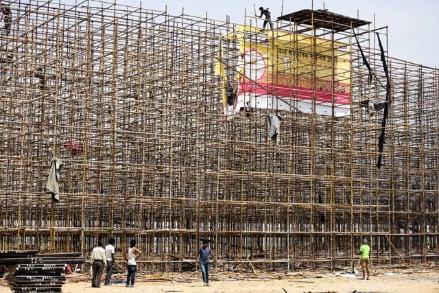 File photo of  labourers disassembling  the stage used during the World Culture Festival organised  near Yamuna flood plain, in New Delhi.