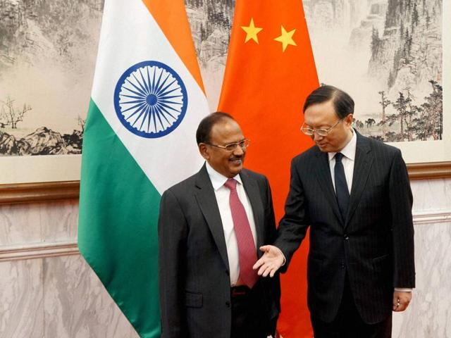 National security advisor Ajit Doval being welcomed by China's state councillor Yang Jiechi at the 19th India-China Boundary talks in Beijing.