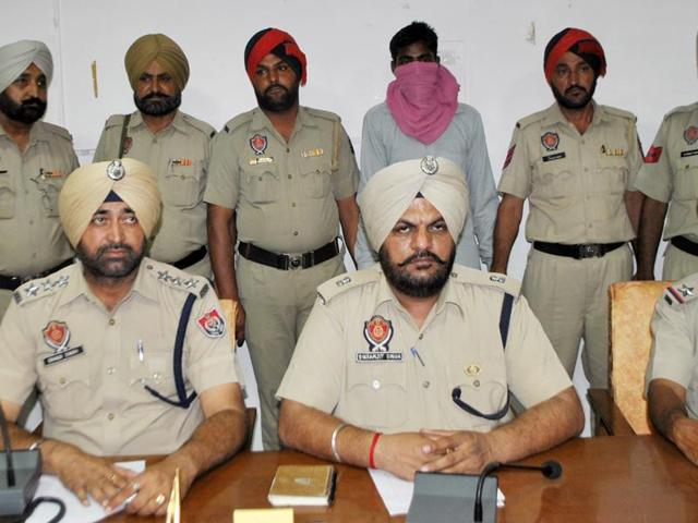 SP Bikramjit Singh (centre) and other policemen with the accused, during a press conference at Bathinda on Wednesday.