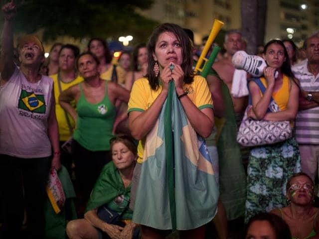 Anti-government demonstrators in Rio de Janeiro watch the vote count on a screen as lawmakers vote on whether or not to impeach President Dilma Rousseff, April 17, 2016.