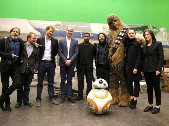 Actor Mark Hamill, director Rian Johnson, Britain's Prince Harry, Britain's Prince William, Duke of Cambridge, John Boyega, Chewbacca and Daisy Ridley pose during a tour of the Star Wars sets at Pinewood studios.