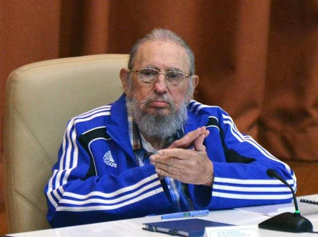 Handout picture released by Cuban Agency ACN showing Cuban Former President Fidel Castro (L) speaking next to Cuban President Raul Castro during the closing ceremony of VII Congress of Cuban Communist Party (PCC) at Convention Palace in Havana, on April 19, 2016.