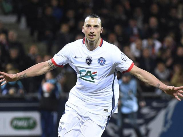 Paris Saint-Germain's Swedish forward Zlatan Ibrahimovic celebrates after scoring a goal during the French Cup semi-final against Lorient at Moustoir stadium in Lorient, France, on April 19, 2016.