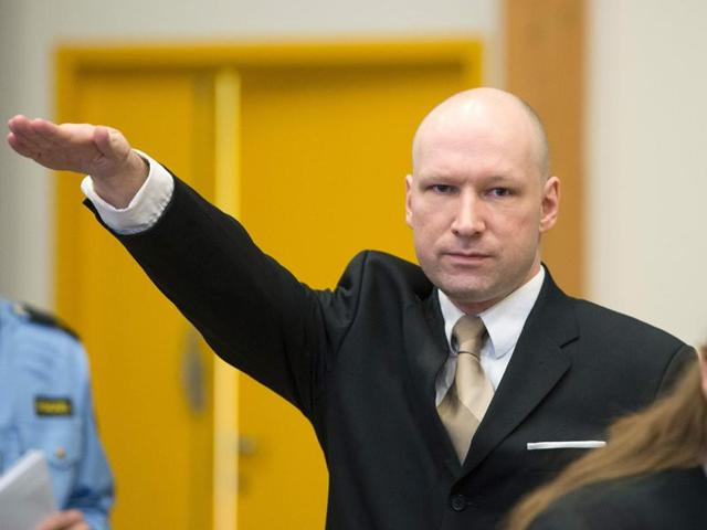 Norwegian mass killer Anders Behring Breivik makes a Nazi salute as he arrives to a makeshift court in Skien prison's gym on March 15, 2016 in Skien, 130 km south west of Oslo.