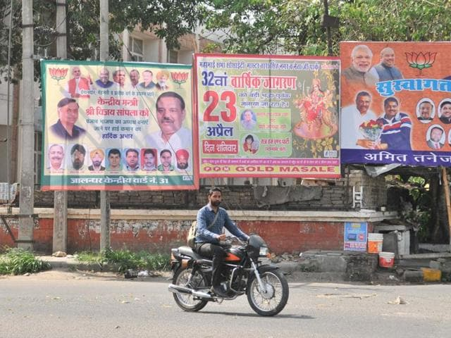 Hoardings of BJP leaders at BSF Chowk in Jalandhar on Tuesday. Similar hoardings of other political parties are also seen in other parts of the city.