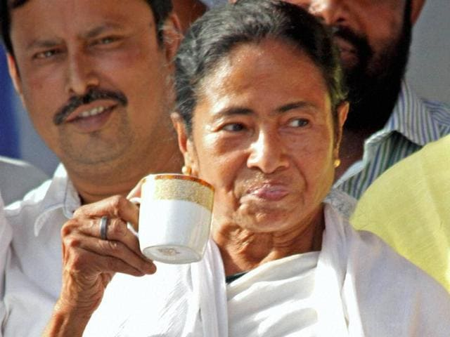 West Bengal chief minister and Trinamool Congress supremo Mamata Banerjee having tea during an election meeting at Suri in Birbhum district.