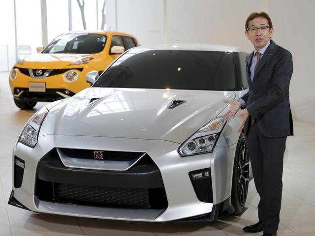 Shiro Nakamura, Senior Vice President and Chief Creative Officer of Nissan Motor Co, speaks in front of the company's GT-R supercar clay model.