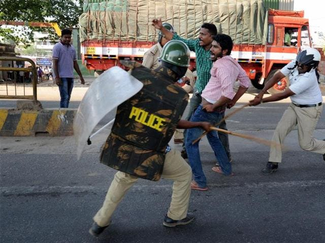 Rapid Action Force personnel on Wednesday staged a flag march along the Jalahalli Cross stretch, one of the worst-hit by the violence, even as police arrested about 50 persons in connection with the untoward incidents.