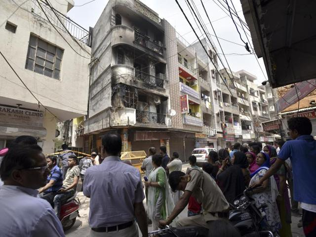 3 people died, and a further 22 were injured in a fire after a LPG cylinder exploded in a four storey building in Sun light Colony in New Delhi on Tuesday, April 19, 2016.