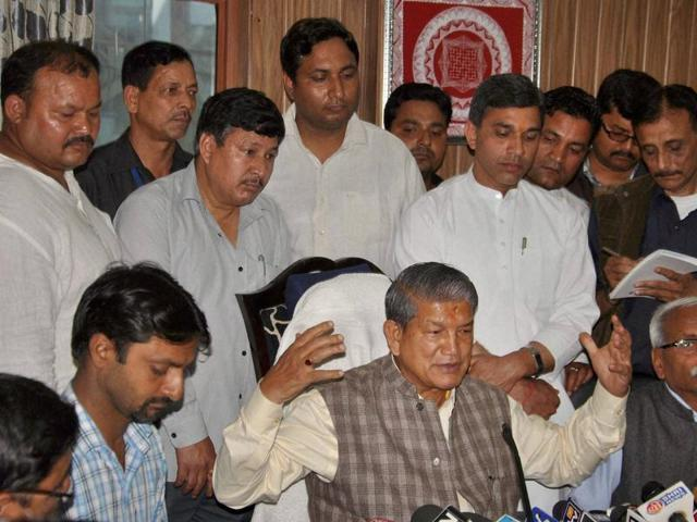 Deposed Uttarakhand chief minister (centre) has filed a plea against the imposition of President's Rule in the state.