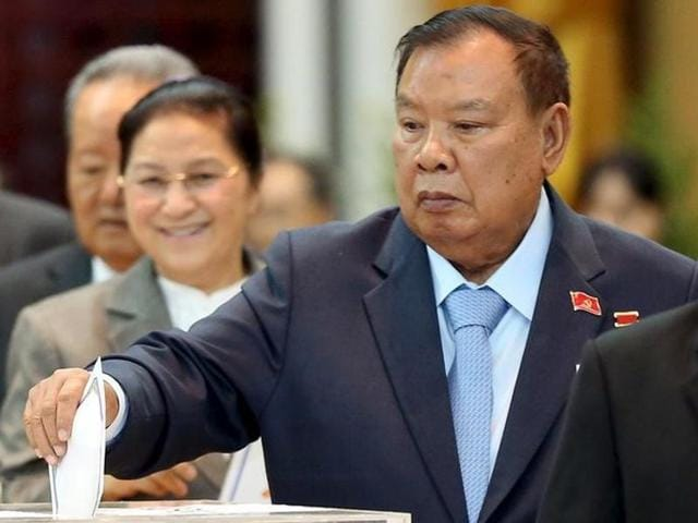 Laos' vice-president Bounnhang Vorachit casts his ballot during the Communist Party Congress in Vientiane on January 21, 2016.