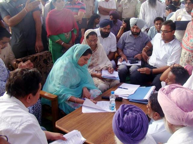 Union cabinet minister Harsimrat Kaur Badal listening to people's grievances during a sangat darshan programme at a village in Bathinda on Wednesday.