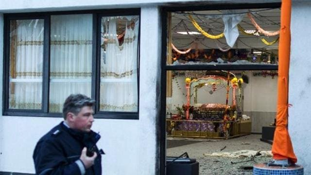 A German policeman stands guard at a gurdwara in the western city of Essen.