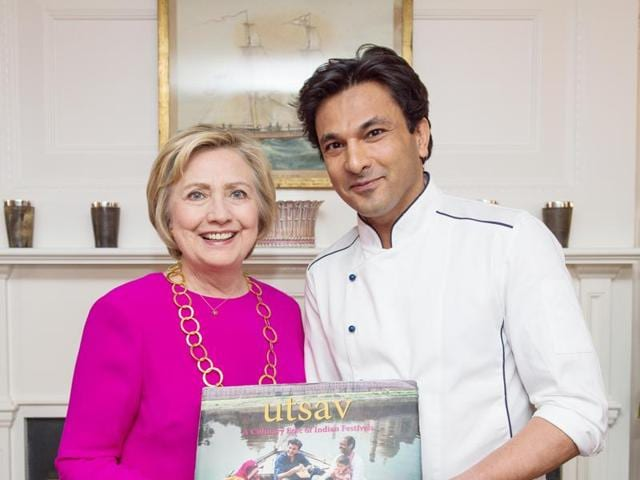 US President Barrack Obama and Vikas Khanna pose for a photograph, after the chef presented his book, Utsav, to him.