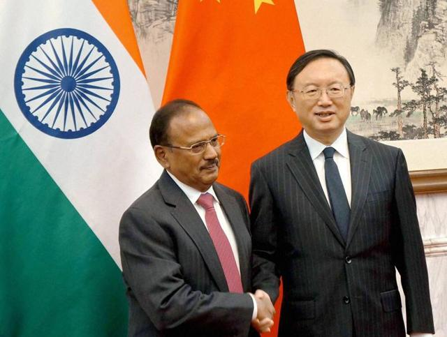National Security Adviser Ajit Doval meeting Chinese Premier Li Keqiang after attending the 19th round of boundary talks in Beijing on Thursday.(PTI)